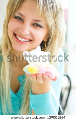 Young happy woman with candies