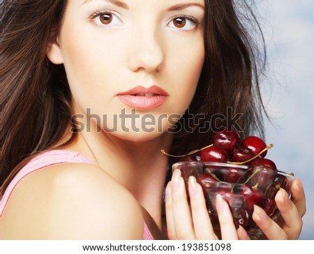 young happy woman with cherries - stock photo