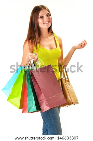 Young happy woman with colorful paper shopping bags isolated on white