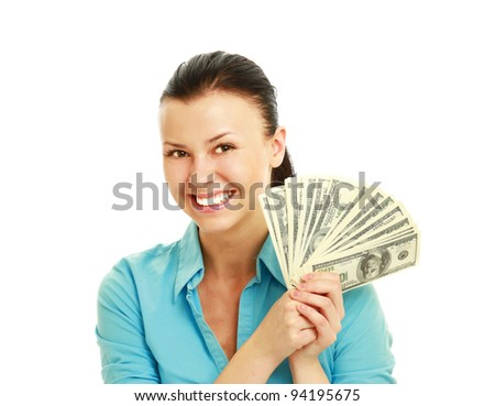 Young happy woman with dollar notes in both hands. Isolated on white background.