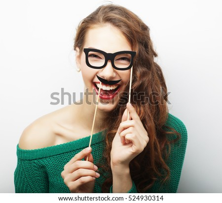 Young happy woman with  fake mustaches