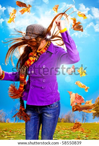 young happy woman with foliage in autumn - stock photo