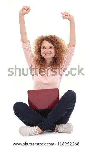 Young happy woman with hands up, isolated on white - stock photo