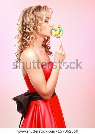 young happy woman with lollipop - stock photo
