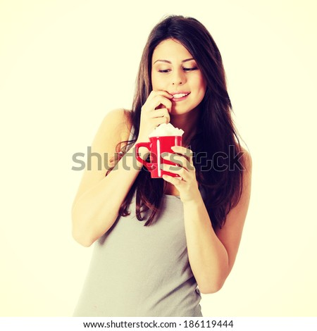 Young happy woman with lot of cugar - stock photo