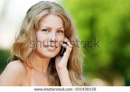 Young happy woman with mobile phone. SMS
