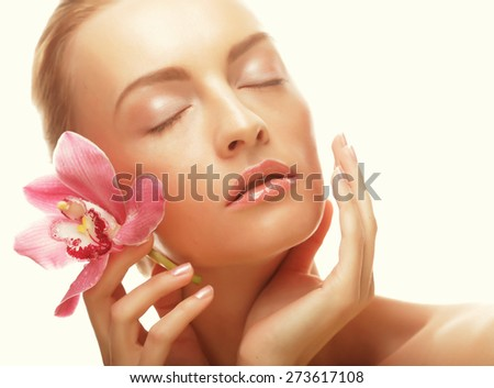 young happy woman with pink orchid isolated on white. - stock photo