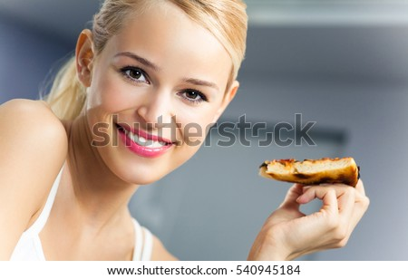 Young happy woman with pizza, indoors. Healthy eating and diet theme concept.