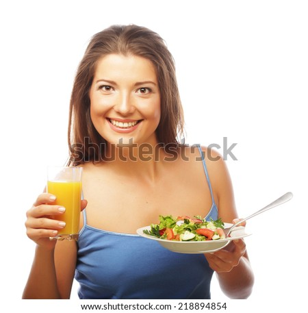young happy woman with salad and orange juice