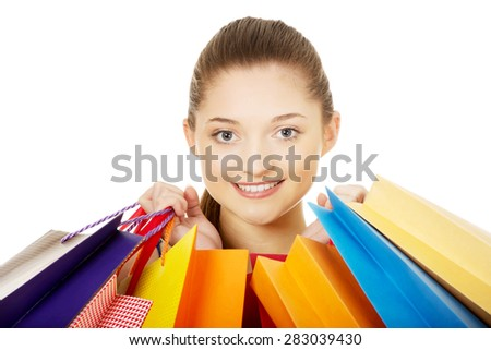 Young happy woman with shopping bags. - stock photo