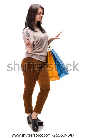 Young happy woman with shopping bags and  dollar cash money on a white background