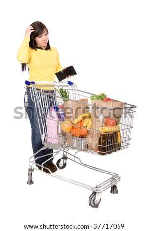young happy woman with shopping cart. over white background