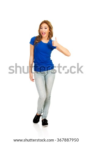 Young happy woman with thumbs up. - stock photo