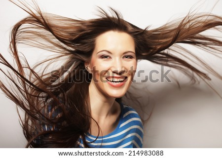 Young happy woman with wind in hair - stock photo