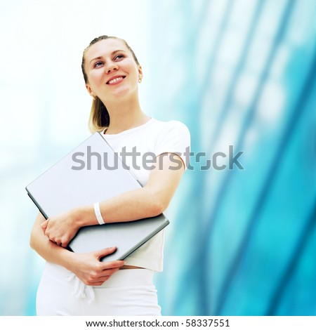 Young happy women or student with laptop on the business background
