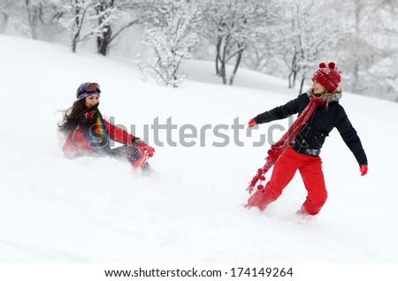young happy women outdoor in winter, enjoying the snow - stock photo