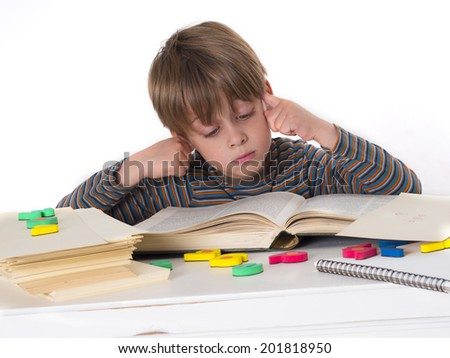 young hardworking schoolboy - stock photo