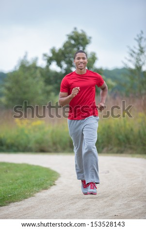 Young Healthy African American Jogging Outdoor Under Morning Sunlight