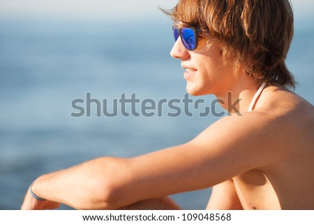 young healthy beautiful men portrait on the beach - stock photo
