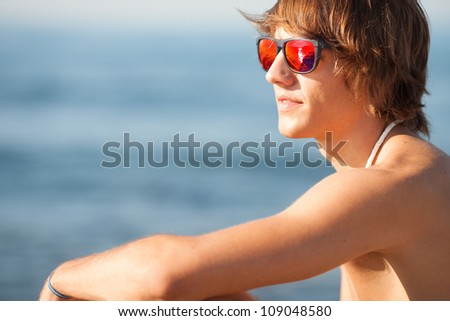 young healthy beautiful men portrait on the beach