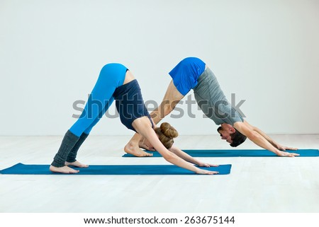 Young healthy couple in yoga position  - stock photo