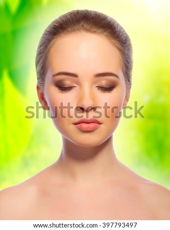 Young healthy girl on floral spring background