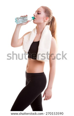 Young healthy girl with bottle of water in hands after practicing sport isolated over white background. Studio shooting - stock photo