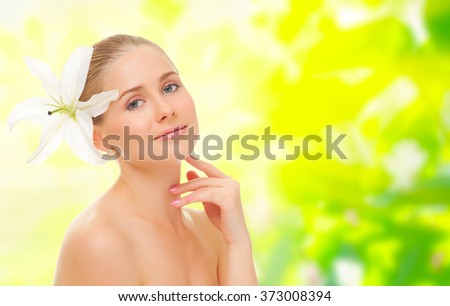 Young healthy girl with flower  on floral spring background - stock photo