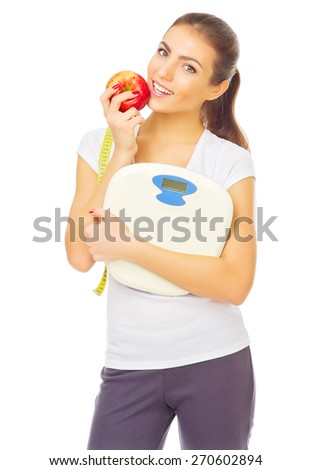 Young healthy girl with scales and apple isolated - stock photo