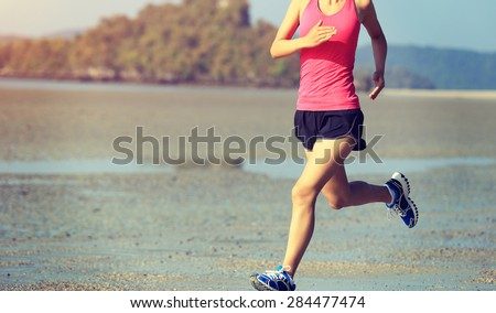 young healthy lifestyle asian woman running on beach