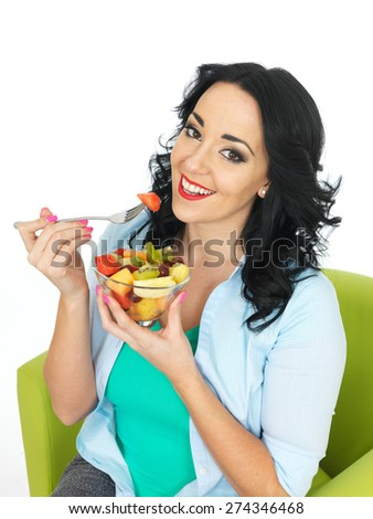 Young Healthy Woman Eating a Fresh Fruit Salad