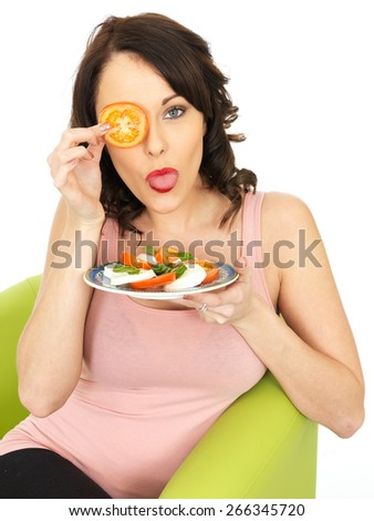 Young Healthy Woman Eating a Mozzarella Cheese and Tomato Salad