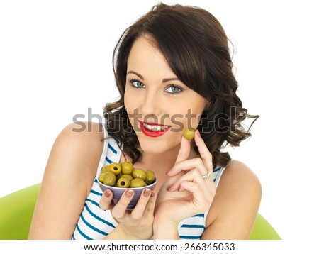 Young Healthy Woman Eating Green Olives