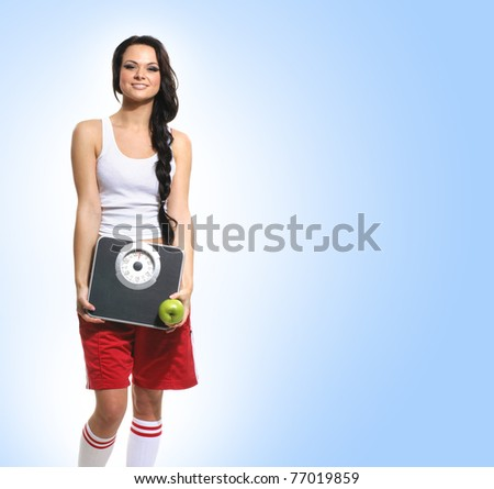 Young healthy woman over blue background - stock photo