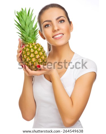 Young healthy woman with pineapple isolated - stock photo
