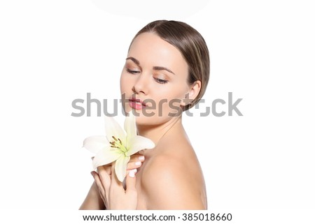 Young healthy woman with white lily flower isolated on white