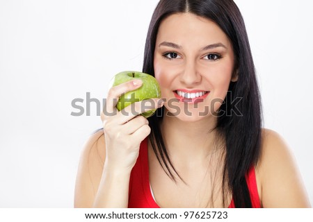 young helthy woman holding fresh green apple