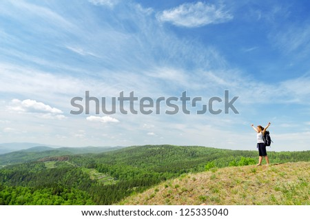Young hiker on the hilltop.