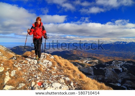 Young hiker steps on the rocky trail on top of the mountain