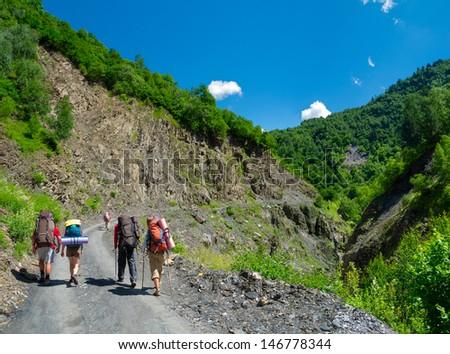 Young hikers trekking in Svaneti, Georgia - stock photo