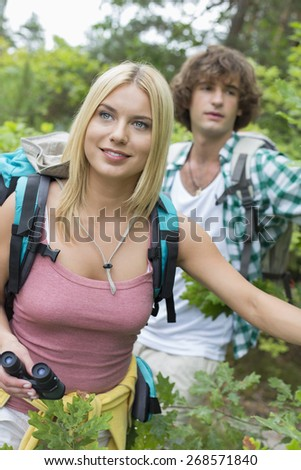 Young hiking couple in forest