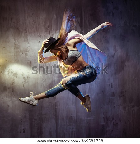 Young hip-hop dancer jumping - stock photo