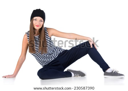 Young hip-hop dancer woman is showing some moves on the white background. - stock photo