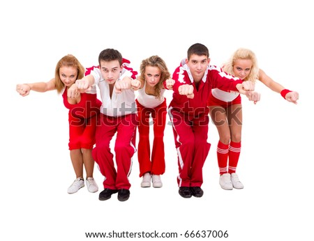 Young hip hop dancers dancing against isolated white background - stock photo