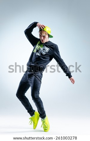 young hip-hopl dancer posing in studio - stock photo