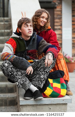 Young hippie couple on the steps
