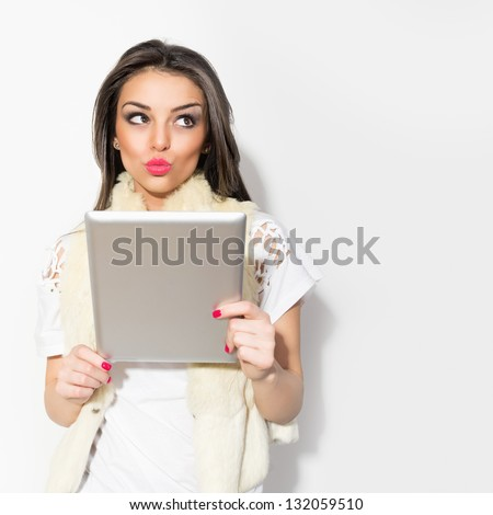 Young hipster brunette woman using digital tablet - stock photo
