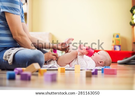 Young hipster father with his cute baby daughter - stock photo