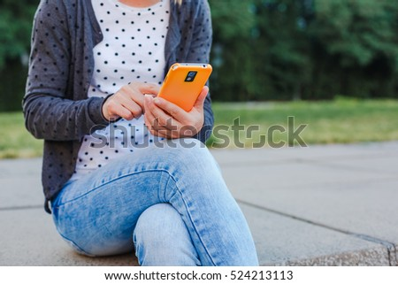 Young hipster girl messaging on smart phone