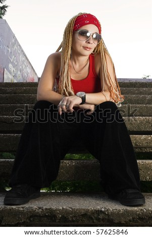 Young hipster girl with braids posing outdoors - stock photo